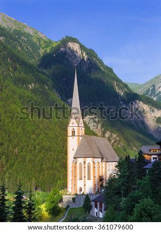 Church in Heiligenblut under Grossglockner peak in Austrian Hohe Tauern,Austria - stock photo