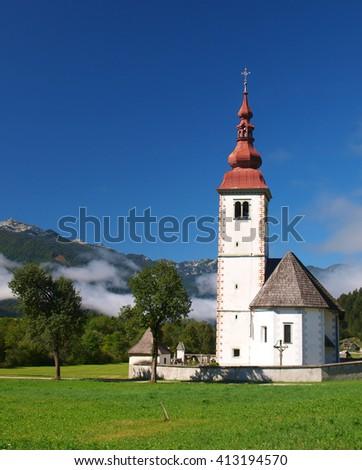 Church in mountain valley, Slovenia - stock photo