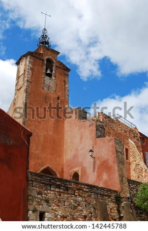 Church in ocher historical village of Roussillon, Provence, France