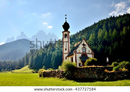 church in the foothills of the Dolomites. Funes Valley, Dolomites, Italy. St John church under autumn sun