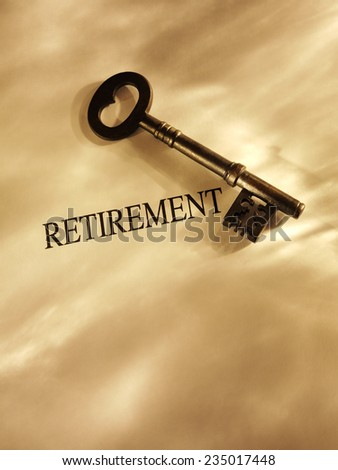 Church key with the word retirement on a paper background with gold lighting and copy space.