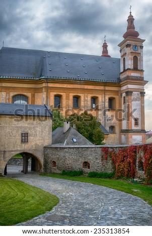 Church of Annunciation and Marian plague column (1719) in Olomouc Region of Czech Republic. - stock photo