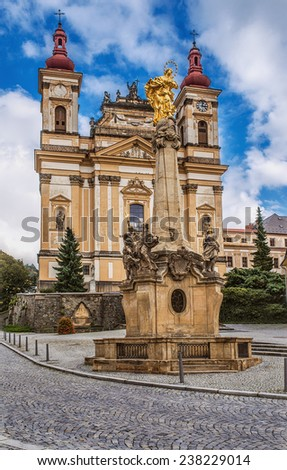 Church of Annunciation and Marian plague column (1719) in Olomouc Region of Czech Republic. - stock photo