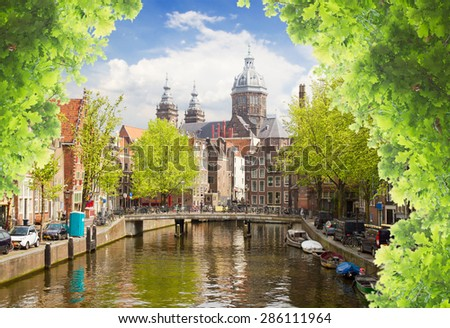 Church of Saint Nicholas, old town canal at summer day, Amsterdam, Holland - stock photo