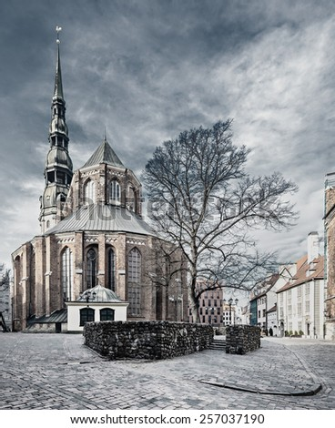 Church of Saint Peter in old Riga, Latvia. Aged image with B&W filter for inspiration of retro style - stock photo