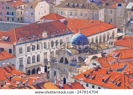 Church of St Blaise surrounded by orange roofs in the old town of Dubrovnik, Croatia - stock photo