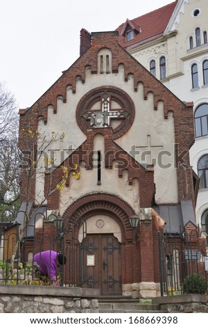 Church of St. John the Baptist founded 1260 and Museum sights of the ancient city founded 1993 in Lviv, Ukraine. - stock photo