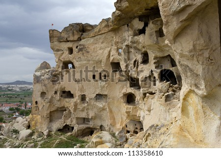 Church of St. John the Baptist in Cavusin, Turkey. Part of its facade collapsed in 1980, is one of the oldest churches in Cappadocia, and dates from the 5th century.  - stock photo