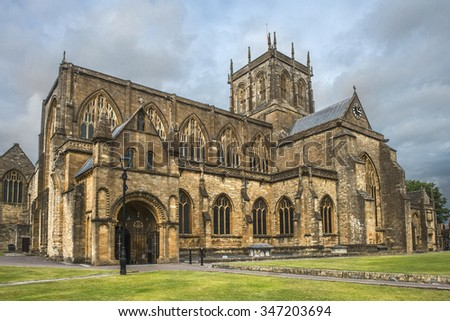 church of St Mary the Virgin, Sherborne Abbey in Dorset, England. It has been a Saxon cathedral, a Benedictine abbey, and now, a parish church - stock photo