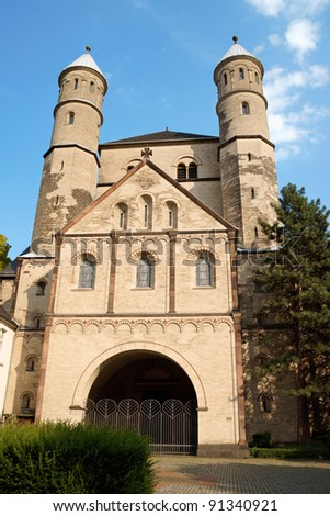 Church of St. Pantaleon in Cologne is the eldest of the 12 romanesque churches in town. It was built on the ruins of a roman villa in 10th century and dedicated to a Greek martyr. - stock photo