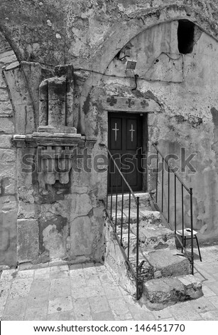 Church of the Holy Sepulchre (top entry) in Jerusalem, Israel (black and white) - stock photo