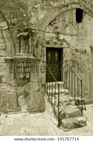 Church of the Holy Sepulchre (top entry) in Jerusalem, Israel (stylised retro) - stock photo