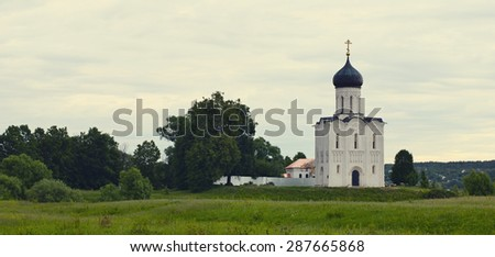 Church of the Intercession on the Nerl (the 12th century) photographed in the cloudy summer morning - stock photo