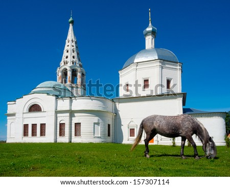 Church of the Sacred Trinity, Serpukhov, Moscow area, Russia. Horse at foreground - stock photo