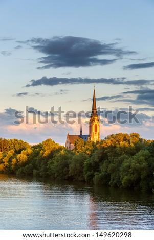 Church on Main river, Frankfurt - stock photo