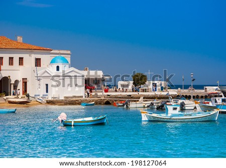 Church on Mykonos by the sea, surrounded by boats - stock photo