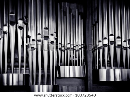 Church organ pipes. The shining of music. - stock photo