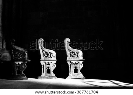Church pews in black and white - stock photo