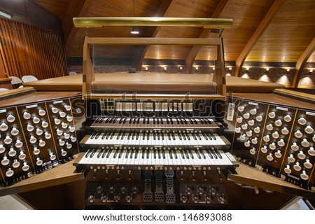 Church Pipe Organ Keyboards Pedalboard and Control Buttons - stock photo