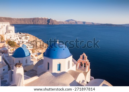 Church rooftop with a blue dome and bells on a sunny day - stock photo