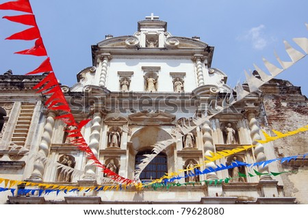 Church San fransisco with flags in Antigua Guatemala - stock photo