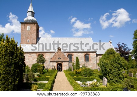 Church, scandinavian medieval place of worship. graveyard and Danish religious architecture - stock photo