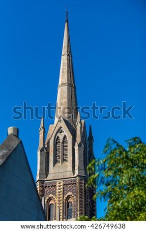 Church Steeple in North Melbourne Australia  - stock photo