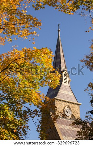 church steeple with fall leaves