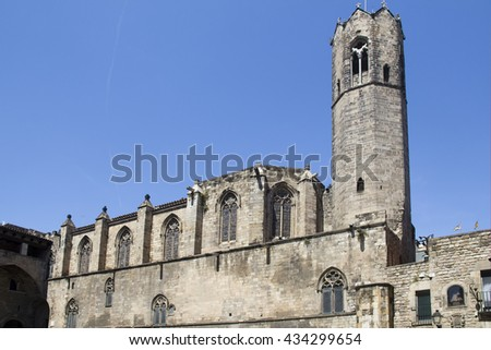 Church tower rising from the narrow streets of Barcelona, Spain - stock photo