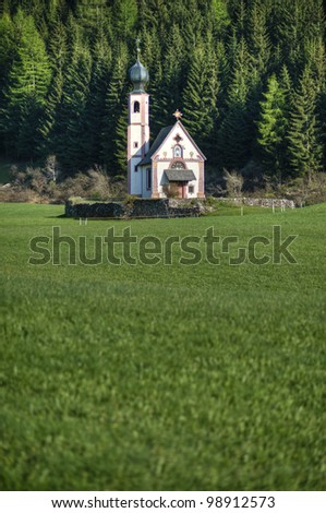 Church with onion dome steeple in Dolomite mountains of northern Italy