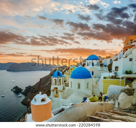 Churches of Oia village during beautiful sunset, Santorini island, Greece