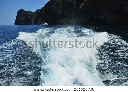 Churning sea water from Speed boat wake in the sea wave splash - stock photo