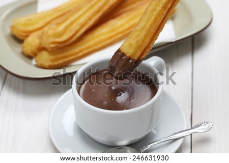 churros and hot chocolate, spanish breakfast - stock photo