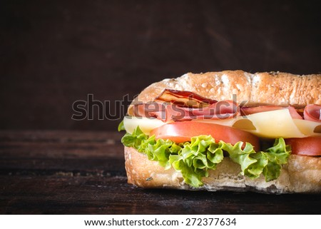 Ciabatta sandwich on wooden background with blank space gor the text  - stock photo