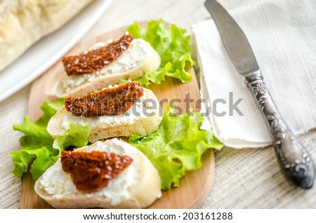 Ciabatta sandwiches with cottage cheese and sun-dried tomatoes - stock photo
