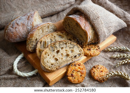 Ciabatta with ears on the burlap - stock photo