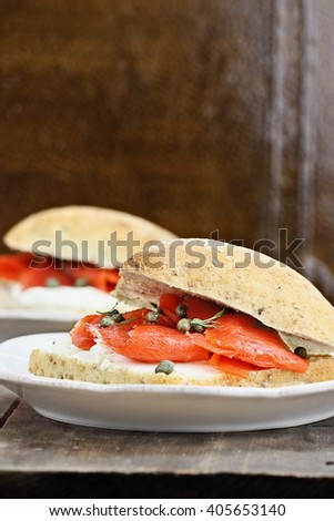 Ciabatta with Salmon, Cream Cheese and Capers. Extreme shallow depth of field with selective focus.