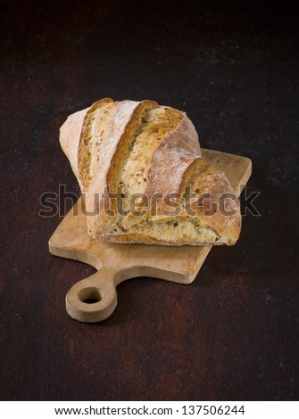 ciabatta with the wooden chopping board - stock photo