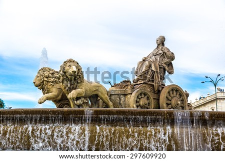 Cibeles fountain at Plaza de Cibeles in Madrid in a beautiful summer day, Spain - stock photo