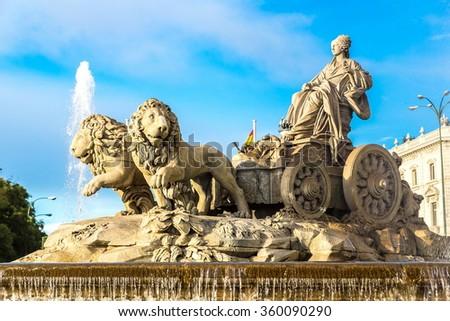 Cibeles fountain at Plaza de Cibeles in Madrid in a beautiful summer day, Spain - stock photo