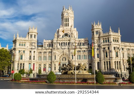 Cibeles Palace and Cibeles fountain at Plaza de Cibeles in Madrid in a beautiful summer day, Spain
