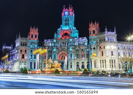 Cibeles square at Christmas, Madrid, Spain. Cibeles fountain in front of the The City Hall or the former Palace of Communications under a special illumination - stock photo