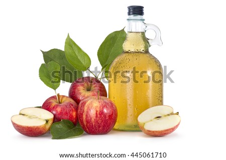 Cider and red apples with green leaves on white background - stock photo