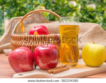 Cider - hot apple beverage on wooden table in garden.