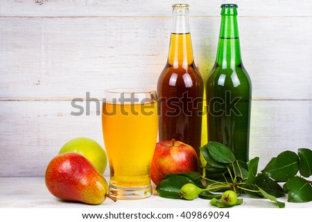 Cider with apples and pears on white wooden background