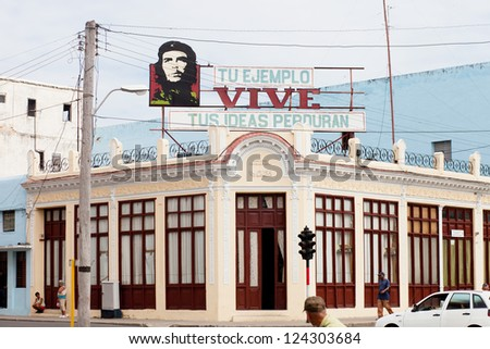 CIENFUEGOS, CUBA - DECEMBER, 22. Communist propaganda with Che Guevara image, one of the icons of the Cuban Revolution after 1959. Taken on dec 22nd, 2012 in Cienfuegos (UNESCO Heritage), Cuba. - stock photo