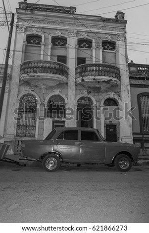 CIENFUEGOS, CUBA - DECEMBER 31, 2016: Vintage classic american car parked in a street