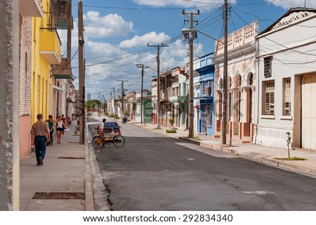 CIENFUEGOS, CUBA - February 5, 2008. One of streets in the center of colonial town of Cienfuegos, Cuba. It is a city on the southern coast of Cuba, capital of Cienfuegos Province.  - stock photo
