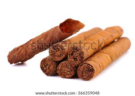 Cigar and tobacco leaf. Cigars. Cuban Cigars. Cigar production in Cuba. Cigar. Handmade cigar. Cigars, Cuba.  - stock photo