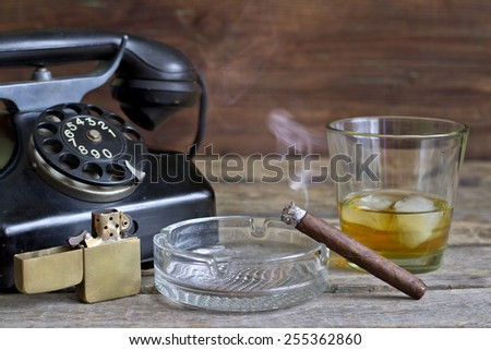 Cigar and whiskey abstract retro still life with telephone - stock photo